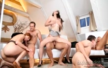 Swinger couples having an orgy